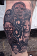 Black and Grey Slipknot full band calf tattoo