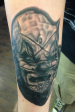 Black and grey slipknot clown portrait tattoo